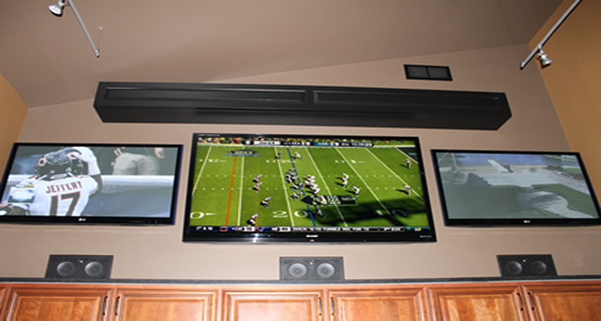 Three large screen TVs with complete Surround